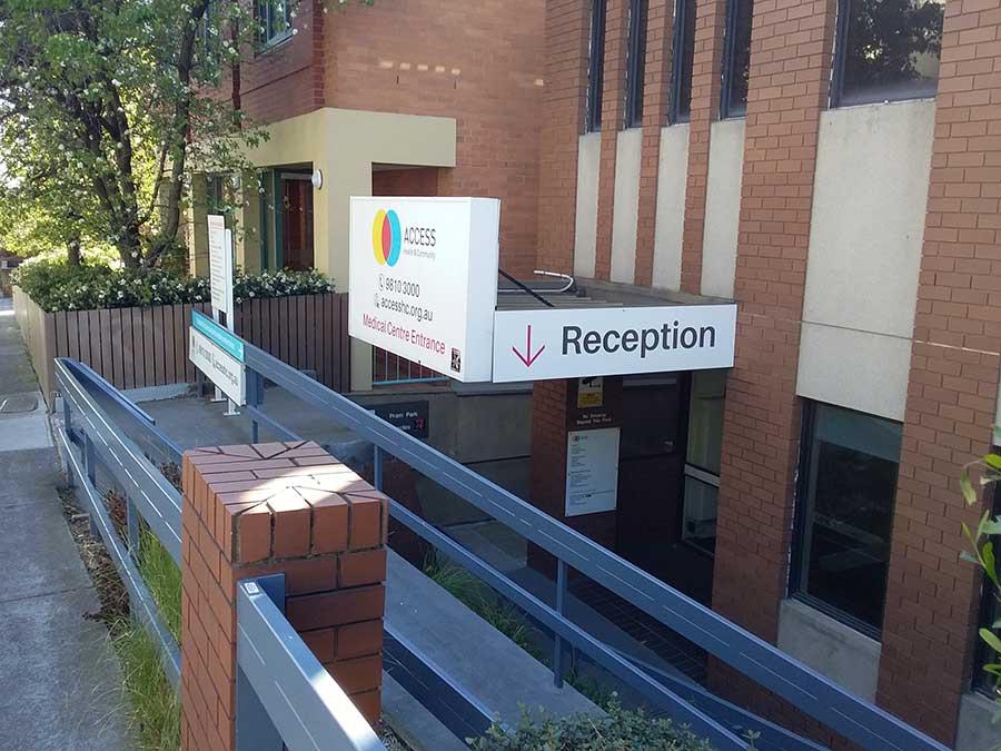 reception sign at access hc richmond clinic